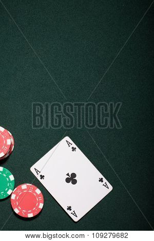 Casino chips on a green background and ace card  in Vegas