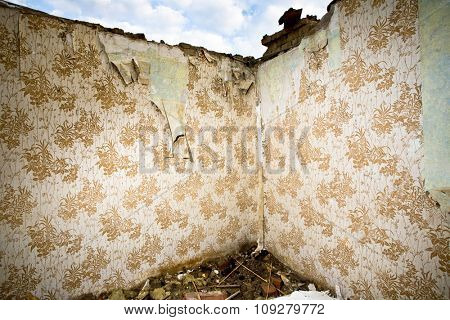 Interior of old ruined and destroyed room. Two walls with retro wallpaper ideal for your designs