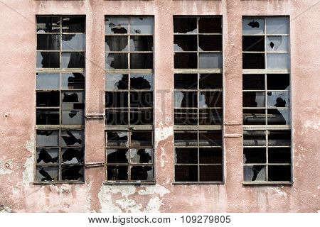 Many broken windows on old abandoned warehouse