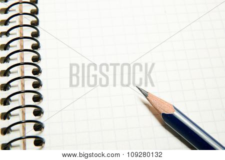 Opened Notebook  And Pencil On Over White