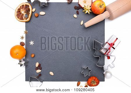 Plate Of Slate With Different Christmas Objects Around It.