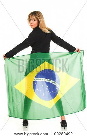 Young woman holding Brazil flag on her back