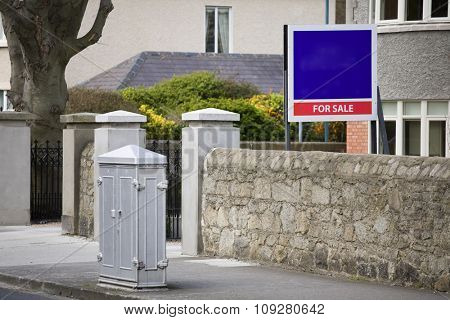 House for Sale with empty sign in front. Real estate concept