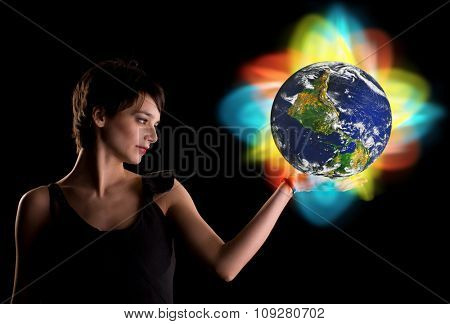 Woman holding world in hand with colorful light around symbolizing big changes