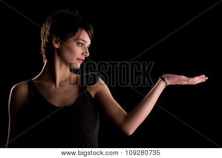 Woman in black dress pretending to hold something that you can easily add on her hand