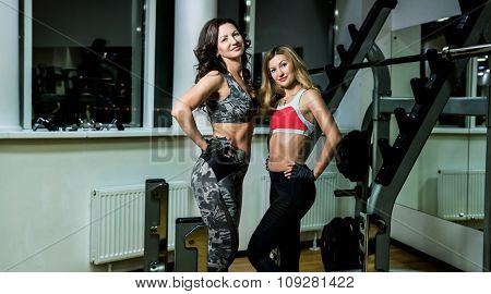 Two Women Posing In The Gym.