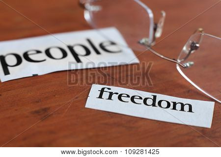 People freedom cut out labels from the newspaper. Human concept