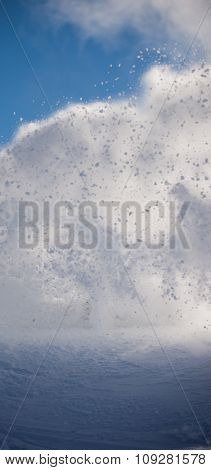 Splashing snow. Vertical winter theme background