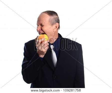 Mature man eating apple isolated on white background