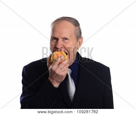 Senior man eating apple