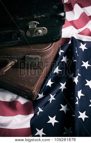 Vintage suit cases on US flag. Travel America concept