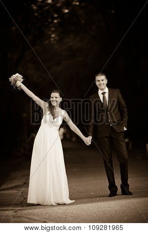 Romantic wedding couple having fun together outdoor