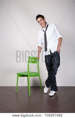 Young guy posing with a chair