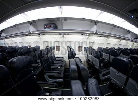 Empty airplane interior sideways. Shot with fisheye lens, same noise