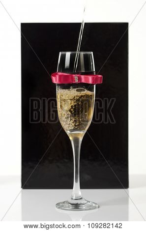 Decorated champagne glass of wine being poured