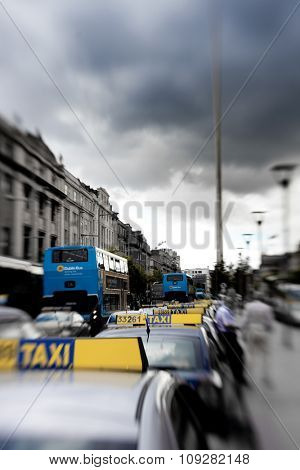 Taxi cars in Dublin, Ireland center symbol - spire with tilt and shift lens