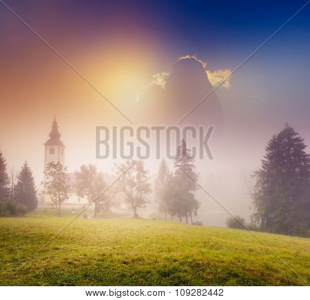 Fantastic foggy view of the National Park Tre Cime di Lavaredo. Dramatic and picturesque morning scene. Dolomites, South Tyrol. Location Auronzo, Italy alps, Europe. Beauty world. Warm toning effect.