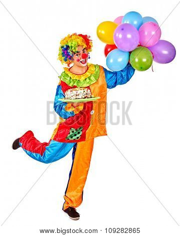 Happy birthday clown on one leg holding a bunch of balloons.  Isolated.