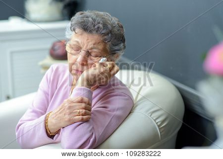 elderly woman on a couch