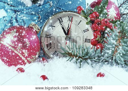 New Year clock with Christmas balls and fir branches