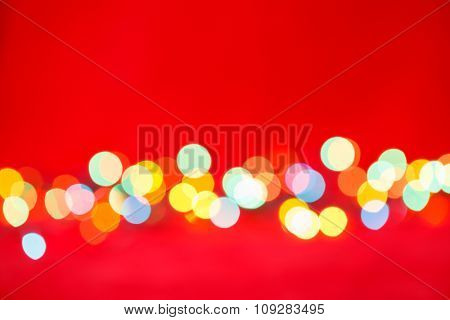 Blurred christmas lights on red background