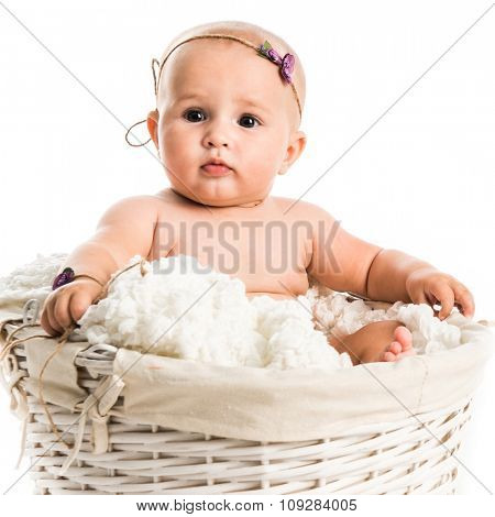 cute little baby in a wicker isolated on white background