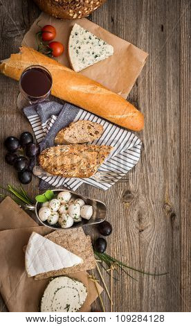 French food on a wooden table with space for text