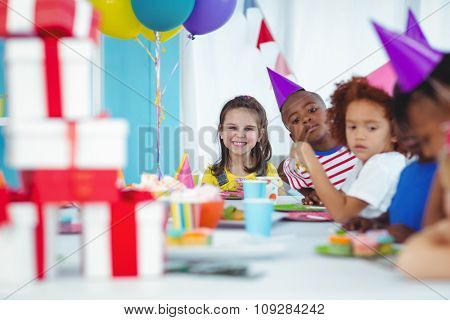 Smiling kids at a birthday party with presents