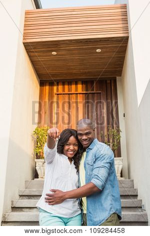 Portrait of happy couple after buying new house