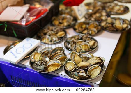 Assortment of fresh raw clams at seafood market