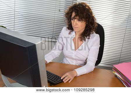 Business Woman Working At Her Office. She Is Very Busy At Business Place