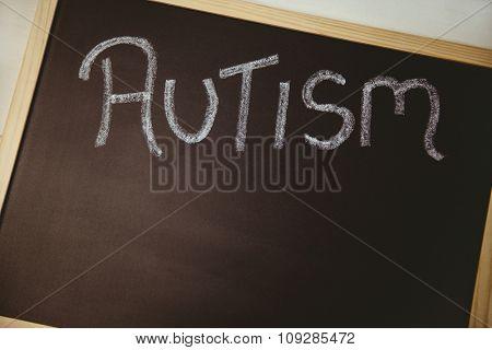 Autism drawn on blackboard shot in studio
