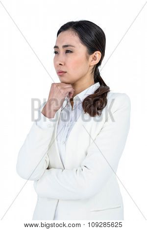 Serious businesswoman looking at something against white background