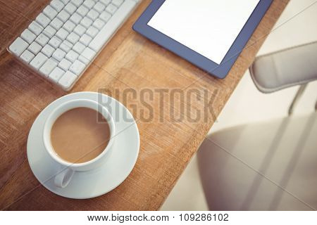 Close up view of business desk with coffee cup and tablet