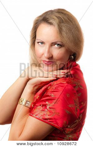 Blond Woman In Red Dress With Coquettish Smile