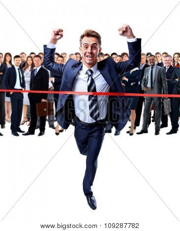 Happy businessman running through finishing line