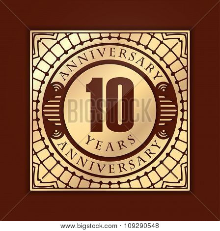 Vintage Anniversary 10 Years Emblem. Retro Styled Vector Background In Gold Tones.