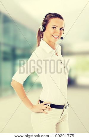 Young business woman in headphones and microphone