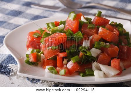 Salmon Salad With Vegetables Close-up On A Plate. Horizontal