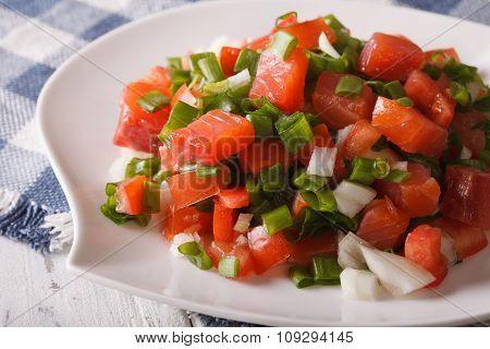 Hawaiian Lomi Lomi Salad Close-up On A Plate. Horizontal