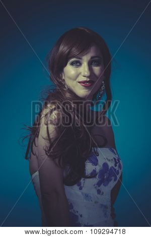 Healthy, Beautiful red haired woman in white dress with flowers and sensual look on clean background, smile and beauty
