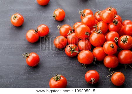 Bunch Of Cherry Tomatoes On Black Board