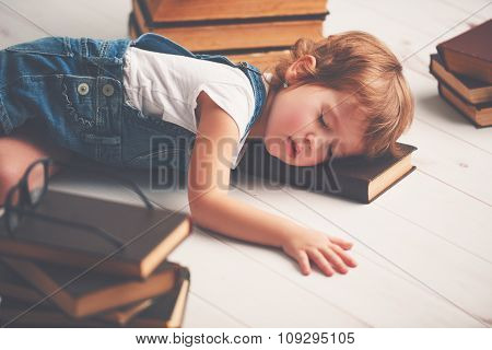 Tired Little Girl Fell Asleep For Books