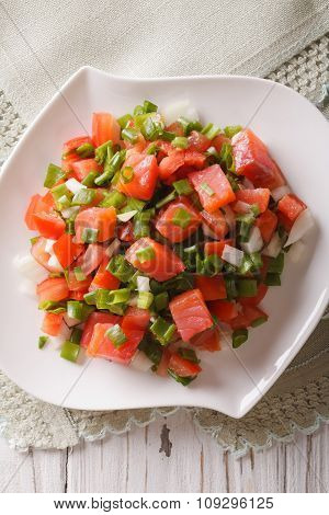 Salted Salmon Salad With Vegetables Close-up. Vertical Top View