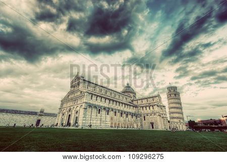 Pisa Cathedral with the Leaning Tower of Pisa, Tuscany, Italy. Popular European landmark. Vintage