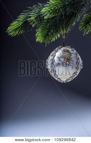 Christmas ball. Luxury christmas ball on christmas tree. Home made Christmas ball hanging on pine tw