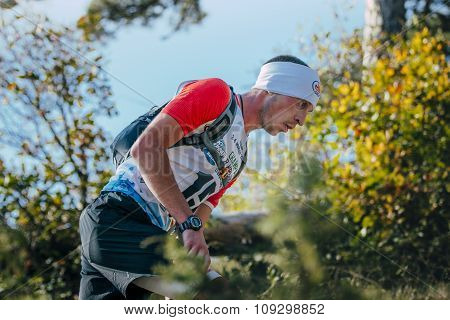 closeup face of young man runner around autumn landscape
