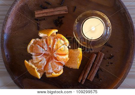 Cristmas orange, candle and spices