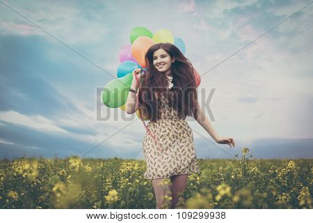 Young beautiful woman in the fields.