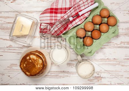 Delicious pancakes and batter ingredients